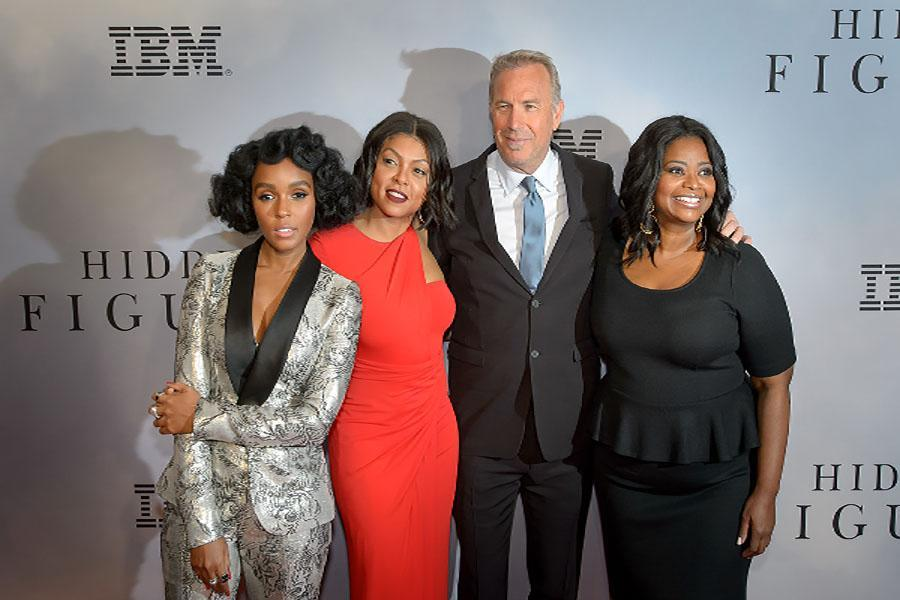 American musical recording artist, actress, and model Janelle Monáe, left, American actress and singer Taraji P. Henson, American actor, film director, and producer Kevin Costner, and American actress Octavia Spencer arrive on the red carpet for the global celebration of the film