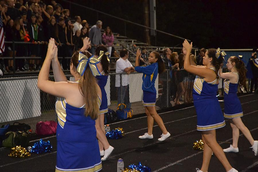 Cheerleaders engage crowd with their cheers