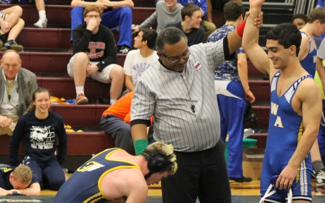 Pinning Opponents to the Mat and Ribbons to his Chest
