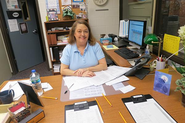 Mrs. Roberts happily looks over her long list of tardies