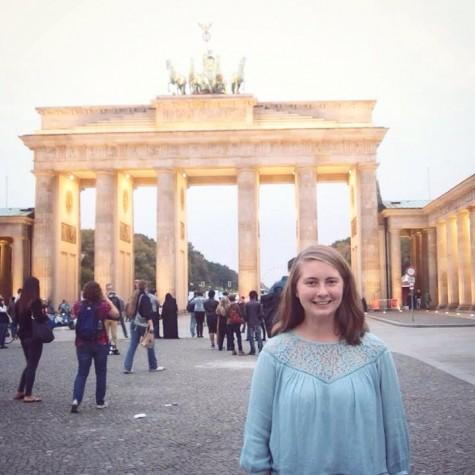 Lauren Kearns standing in front of the Brandenburg Gate.
