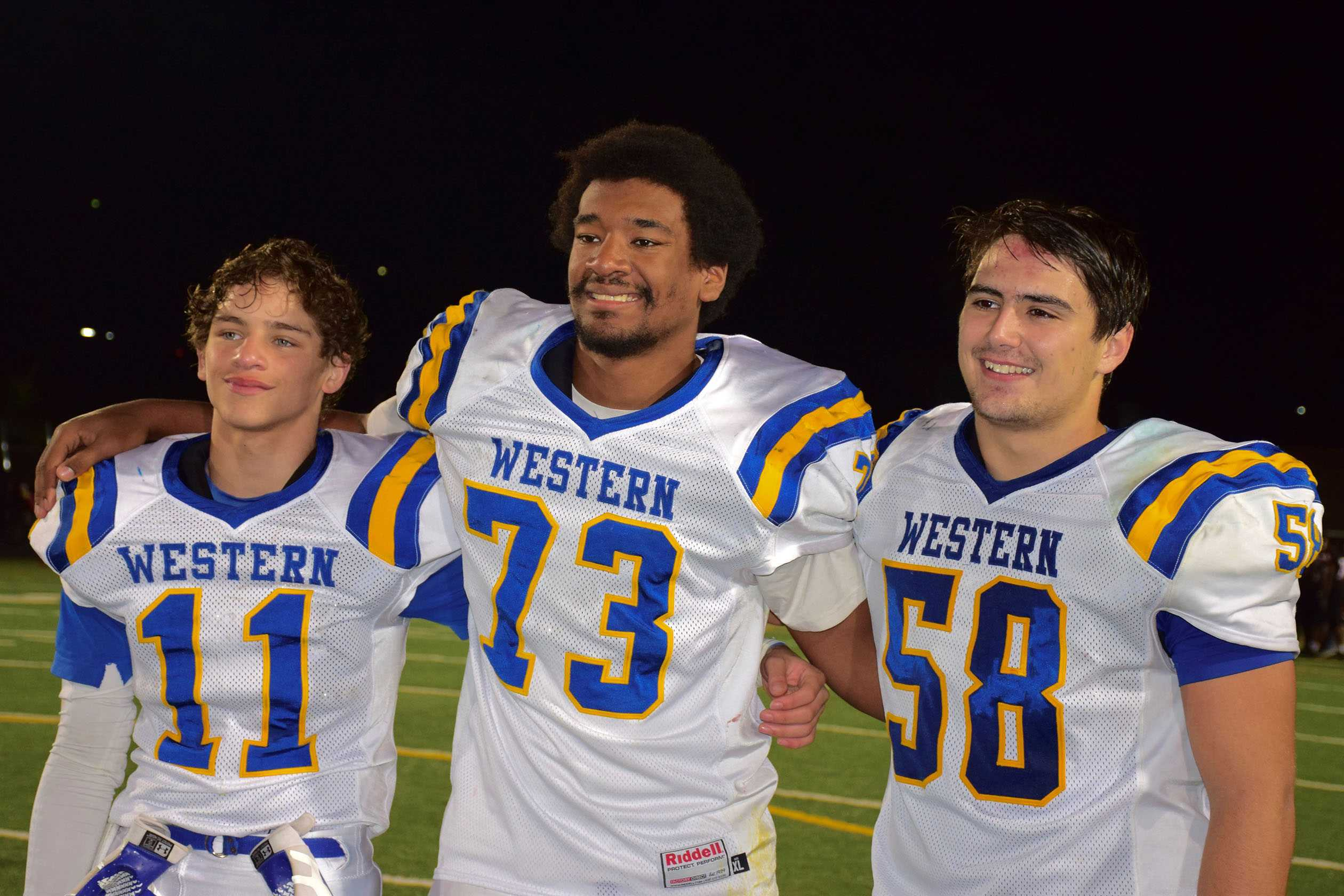 Crutchfield (center, 73) smiles for pictures after win over CHS.