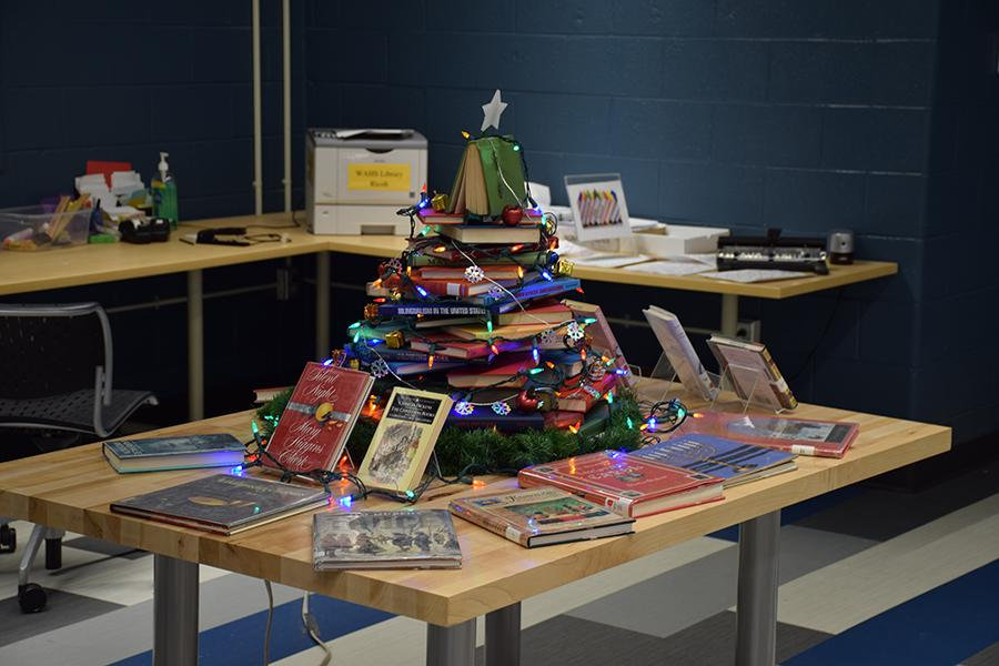 The illuminated tree of books in the library spreads cheer to hardworking students.