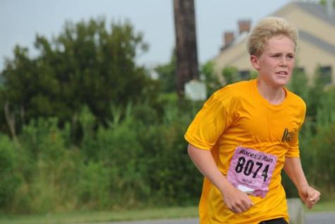 Boys Cross Country Team Running Back To States