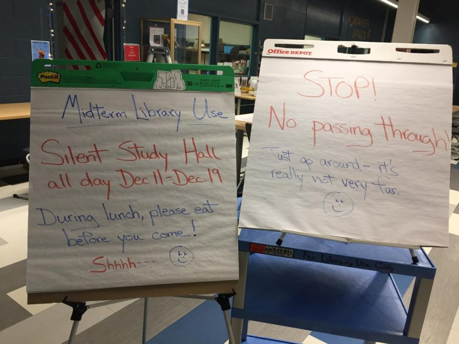 Signs in the library tell students about the all day study hall