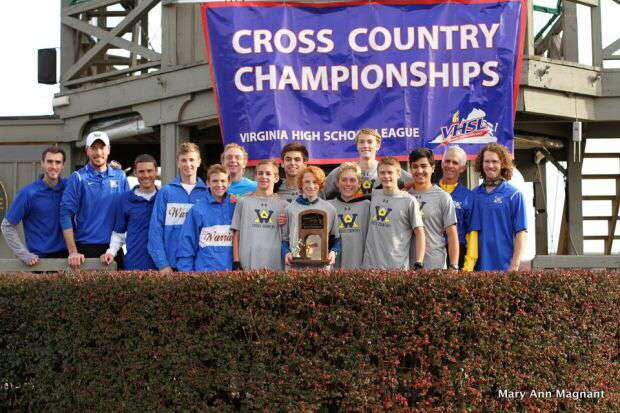 The+boys+cross+country+team+pose+with+their+trophy.