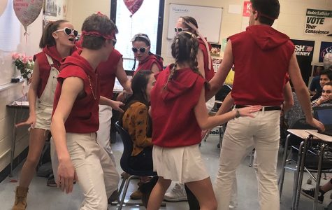 Senior Alice Ferrall receives a singing valentine from Johnny Riordan, Charlie Reichart, Savannah Wilson, Jed Strickland, Jane Romness, Abby Zimmerman, Teo Rampini, and Max Miller.