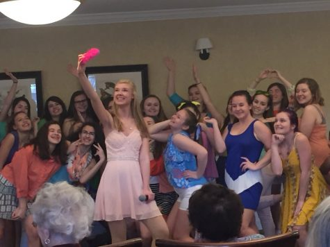 Chloe Horner (Elle) initiates a selfie with Delta Nu girls at a preview performance at the Old Trail Lodge