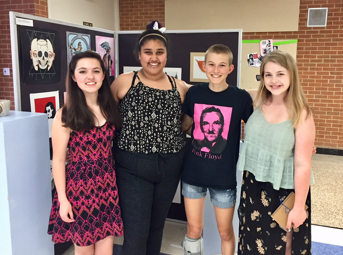 Gayathri Prakash with her fellow senior artists at the Senior Art Show. From left to right: Laura Bendick, Gayathri Prakash, Zoe Clay, and Emma Schmidt.