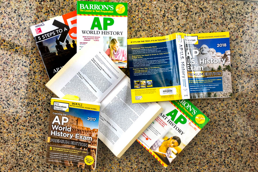 In place of the stringently regulated College Board logo, The Western Hemisphere decided to feature a *completely* unstaged mess of AP review books scattered on the floor in C-hall.