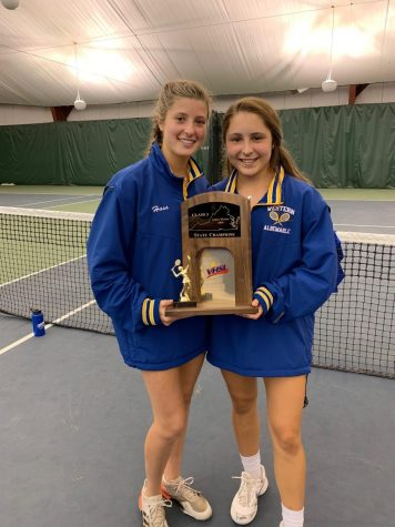 Austin Winslow, at right, and teammate Stephanie Hass hold the state championship trophy after winning the tournament last year.