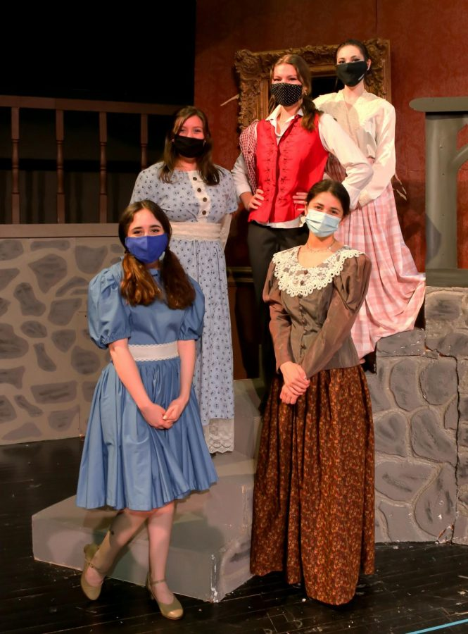 The March family (l-r):  Lilly Clark as Meg, Ainsley Miller as Beth, Baylee Hughes as Jo, Elke Beaumont as Marmee, and Sophia Christiansen as Meg.